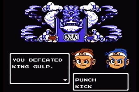 "This shows the final battle with King Gulp at the end of little ninja brothers on Hard Mode.  King Gulp, in a blue frozen pallet, is shown with Jack and Ryu in the foreground.  After landing the final kick the battle has ending with the message, ""You Defeated King Gulp"" displayed."