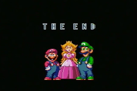The final ending screen of Super Mario World where mario and luigi are standing with the princess in the middle.  The text, 'the end' is displayed underneath the group.